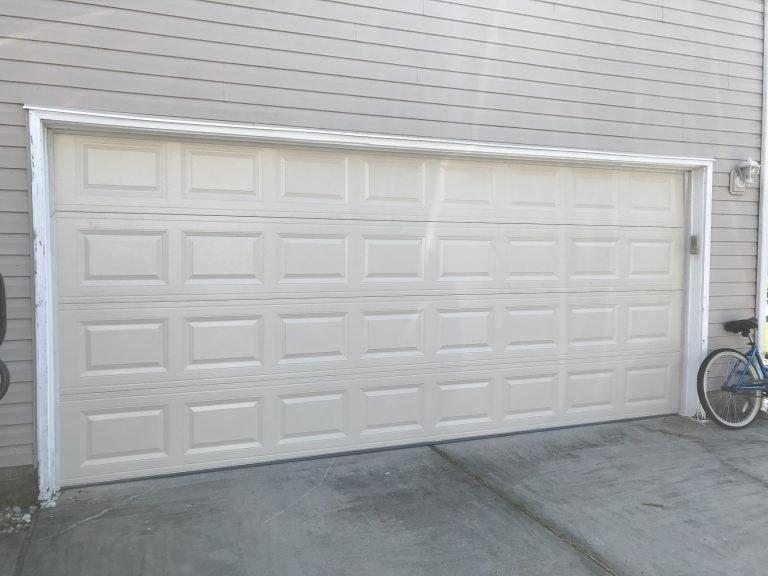 """16""""x7"""" Almond CHI Garage Door Installation"""